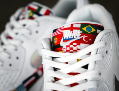 sports shoes 04009 d618d Nike Dresses Three Sneakers in Flags for the World Cup
